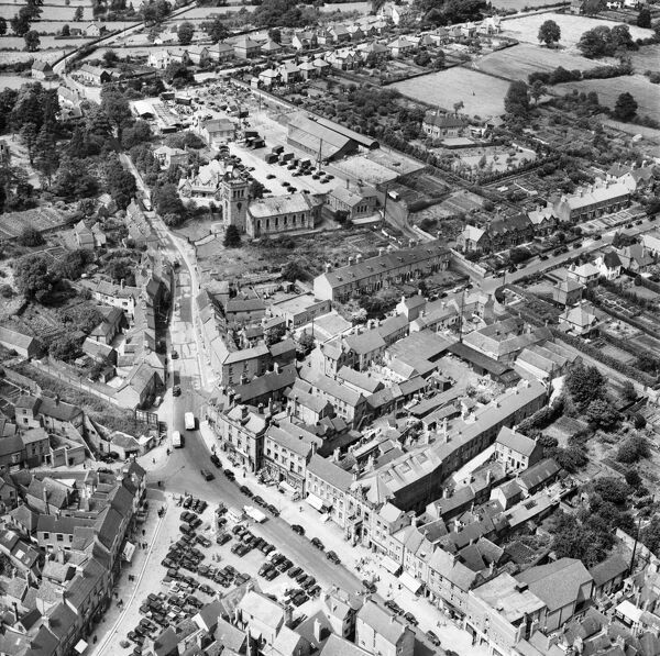 The Market Place, the Church of John the Baptist and the Cattle Market, Ashbourne, Derbyshire. Photographed by Aerofilms Ltd in July 1949