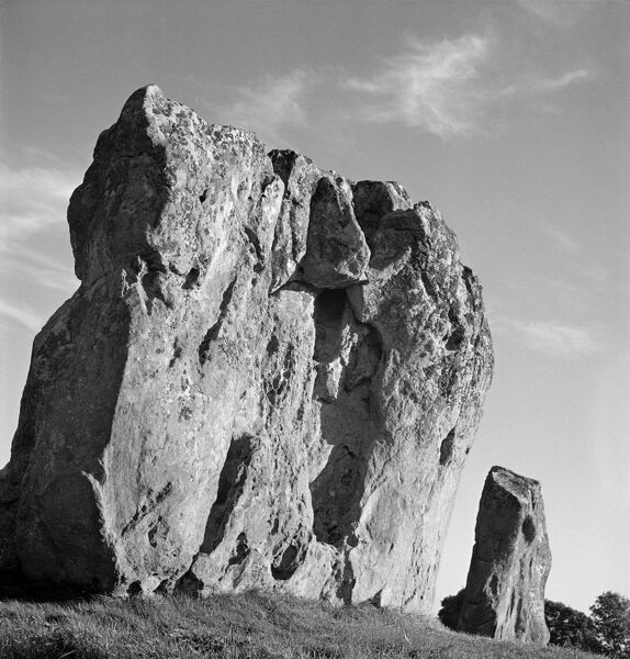 Avebury, Wiltshire. Standing stones in the south-east sector of Avebury stone circle, showing the 'Devil's Chair' in the foreground. Photographed by John Gay (date uncertain)
