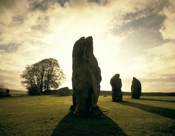 AVEBURY STONE CIRCLE, Wiltshire. Sunrise over the stones