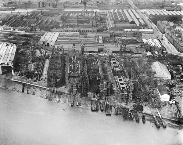 BARROW-IN-FURNESS, Cumbria. Aerial view of the shipyard in July 1920 with four ships in various stages of completion
