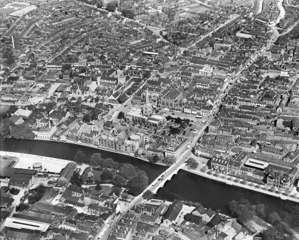 St Pauls Church and the town centre, Bedford. The Great Ouse and Town Bridge are prominent. Photographed in May 1929 by Aerofilms Ltd