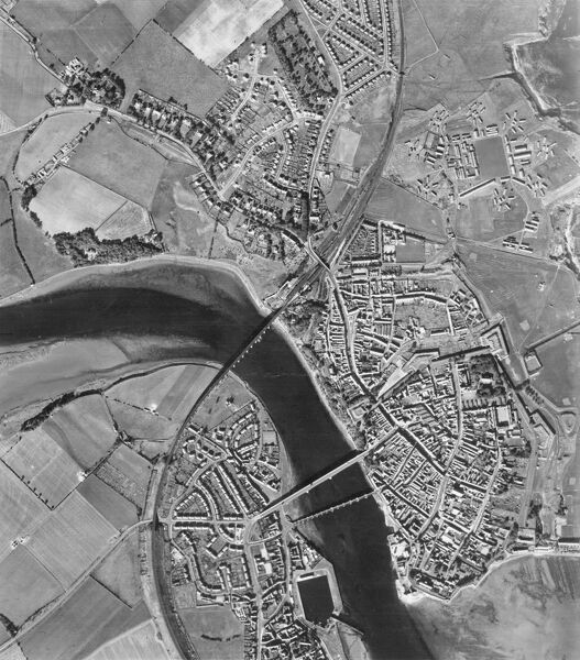 Berwich-upon-Tweed. A facinating birds-eye view showing Tweedmouth, the walled town, bridges and castle. Berwick Holiday Park now occupies the site of the military camp. Photographed by the RAF in 1951