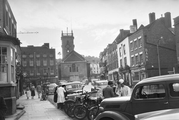 Bewdley, Worcestershire. A view looking west along Load Street towards St Anne's Church with cars and motorbikes parked in the foreground. Photographed by Andor Gomme in September 1957