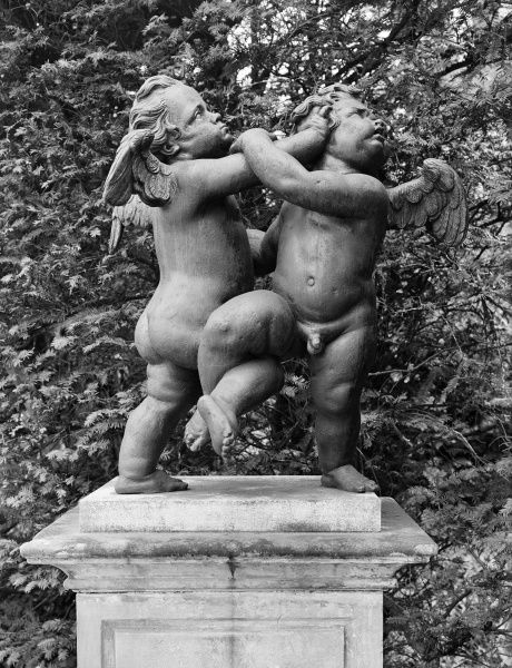 MELBOURNE HALL, Derbyshire. Lead garden figures on a plinth entitled Cherubs - the Quarrel. Photographed in 1954 by G B Mason for the National Buildings Record