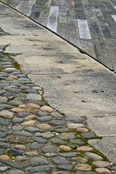 Cobbles, concrete and timber boarding