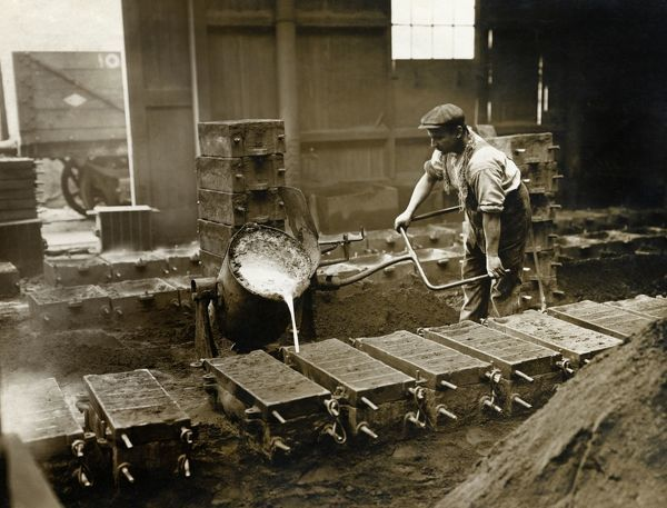 Crewe Locomotive Works, Forge Street, Crewe, Cheshire. Pouring molten metal into moulds to cast chairs. From the L G Fisher Collection, photographed in 1910