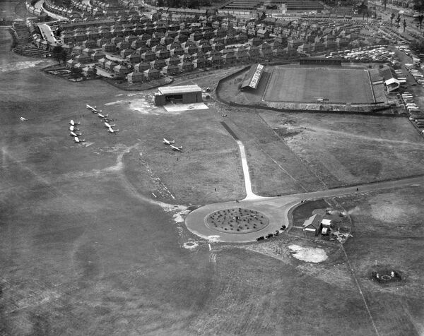 DONCASTER AIRPORT AND BELLE VUE STADIUM. View of the airfield and the home of Doncaster Rovers Football Club, photographed in 1935. Aerofilms Collection (see Links)
