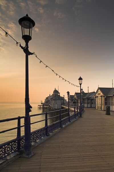 EASTBOURNE PIER, East Sussex. The pier boardwalk at sunset