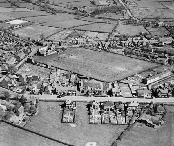 The Clutsom and Kemp Ltd Elastic Factory and adjacent playing field, Ibstock, Leicestershire. Photographed by Aerofilms Ltd in April 1946