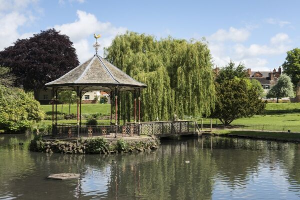 Gheluvelt Park, Barbourne, Worcester, Worcestershire.  Bandstand and the pond within Gheluvelt Park, viewed from the south. Photographed in 2015