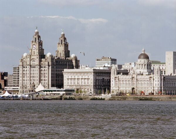 PIER HEAD, Liverpool, Merseyside. General view of the Three Graces, Liverpool, taken from Birkenhead across the River Mersey