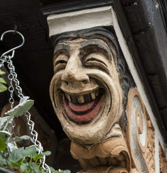 The Station Public House, formerly The Stoneleigh Hotel, The Broadway, Stoneleigh, Ewell, Surrey. Built in 1934-5. Detail of a painted corbel bracket depicting a laughing face near the entrance