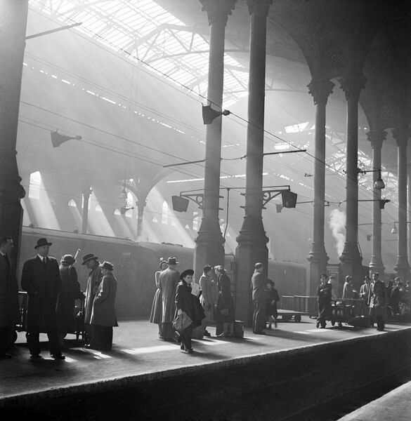 LIVERPOOL STREET STATION, London. Interior view. Passengers waiting for a train on a platform at Liverpool Street Station. Photographed by John Gay. Date range: 1947-1948