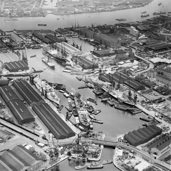 LONDON DOCKS, Southwark. Aerial photograph of Greenland Dock, Rotherhithe in June 1958. Also showing South Dock, the River Thames and the entrance to the Millwall Outer Dock (on the Isle of Dogs). Freighters are unloading into barges and butties