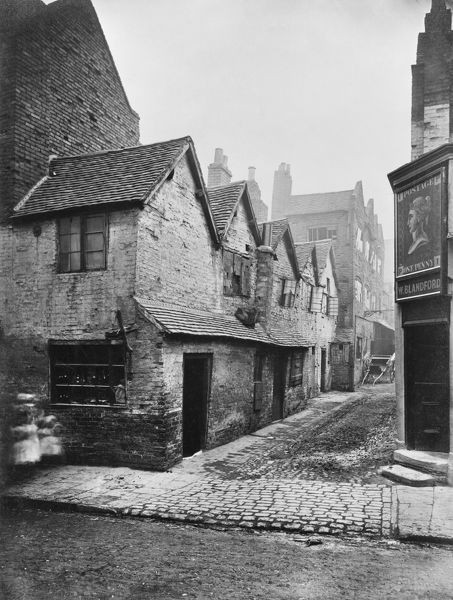 A view from Steelhouse Lane, Birmingham looking into Queen's Head Yard, the door to the Queen's Head Tavern to the right. Glass plate negative photographed 1875