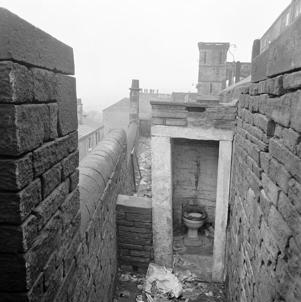King Cross, Halifax, West Yorkshire. An outdoor privy associated with the Victorian back to back houses and underdwellings of Wainhouse Terrace, which formerly stood between the Rochdale and Burnley Roads. Photographed by John Gay 1962-72
