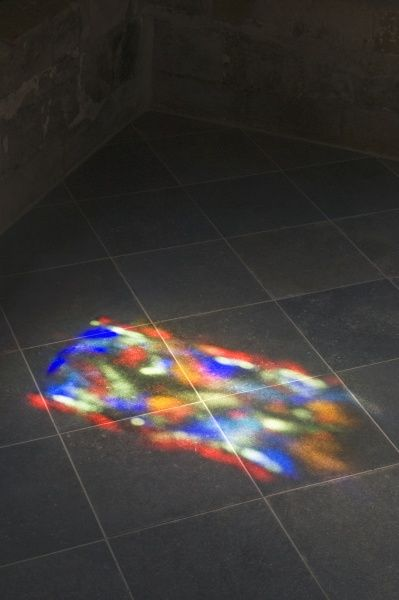 DOVER CASTLE, Kent. Patterns of colour and light fall on the tiled floor from the stained glass windows in the chapel of the Great Tower