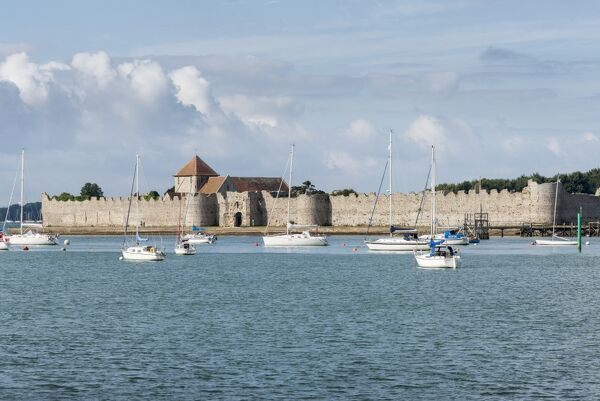 PORTCHESTER CASTLE, Hampshire.The Watergate and Roman Walls, seen from across the harbour. General view from the east