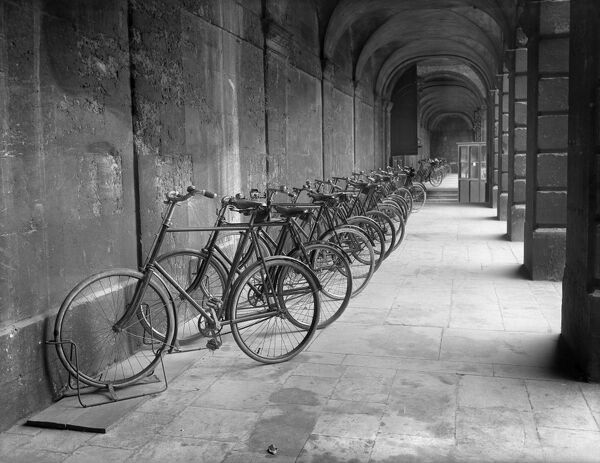 QUEEN'S COLLEGE, Oxford, Oxfordshire. A 1903 view looking west along the south arcade of the front quad with parked bicycles belonging to members of the college. The fine classical quad was built gradually over the first half of the 18th century