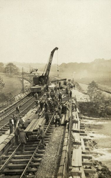 Plymouth area. Renewal work being carried out on the girders and rail bearers of part of the South Devon and Tavistock Railway, using a mobile crane. This view possibly shows the stretch of line east of Plymouth near Crabtree or Marsh Mills