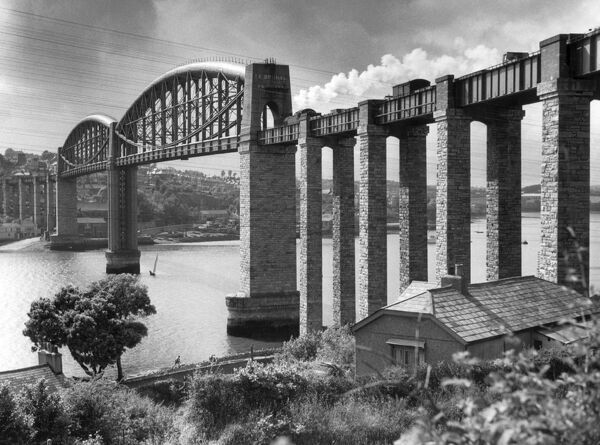 Royal Albert Bridge, Saltash, Cornwall. This bowstring tubular plate girder railway bridge over the River Tamar connects Devonport in Devon to Saltash in Cornwall. Built by the engineer I K Brunel, work began on the bridge in 1848 and was completed in 1859
