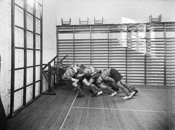 Launceston College, Launceston, Cornwall. Students practising on a wall mounted scrummage machine in the school's gymnasium. Photographed by Marshall Keene and Company between 1931-1939