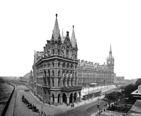 ST PANCRAS HOTEL (or Midland Grand Hotel), Camden, London. St Pancras Hotel was built to the Italianate Gothic designs of Sir George Gilbert Scott in 1868-74. St Pancras Station is also visible stretching from right to left behind the hotel