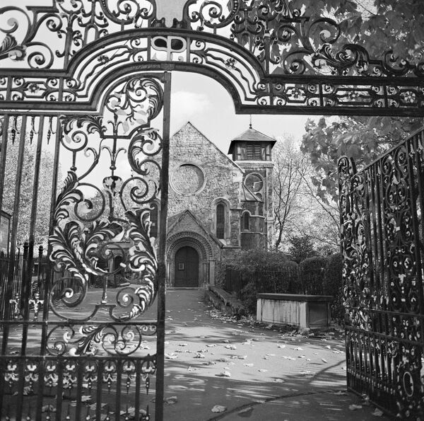 ST PANCRAS OLD CHURCH, Camden Town, London. A view through the wrought iron gateway leading into St Pancras Gardens. Photograph by John Gay. Date range: 1960-1972