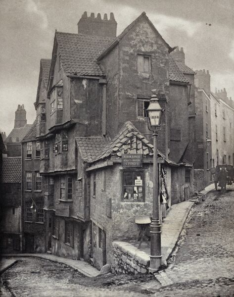 The junction of Steep Street and Trenchard Street, Bristol, 1866. John Hill Morgan (b 1833), platinum print. This view was recorded five years before Steep Street, curving away to the left, was demolished and replaced by a realigned road, Colston Street