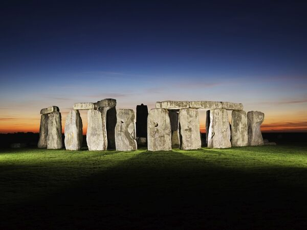 STONEHENGE, Wiltshire. A floodlit view of Stonehenge. Late evening / dusk