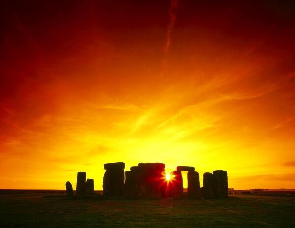 STONEHENGE, Wiltshire. Mid-Summer sunset