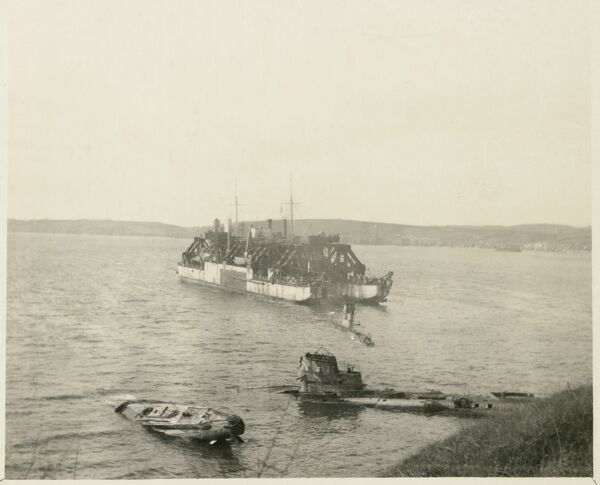 Falmouth, Cornwall. A view from the shore of the lifting rig Cyklop, with two stranded submarines in the foreground, and another between Cyklop and the shore. Five German U-boats were moored at Falmouth after being surrended to the Royal Navy in 1918