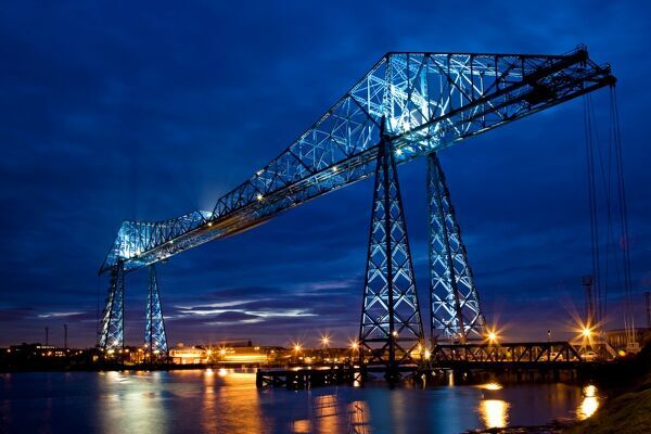 TEES TRANSPORTER BRIDGE, Middlesbrough, Cleveland. General night view of the gondola bridge built across the River Tees in 1911