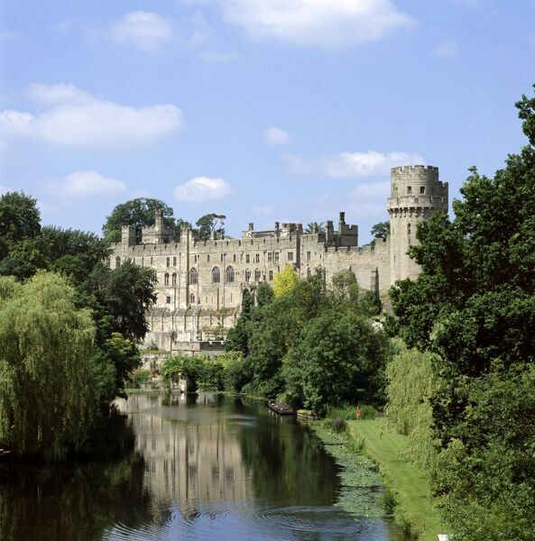 WARWICK CASTLE, Warwick, Warwickshire. A view of the castle from the east with River Avon in the foreground