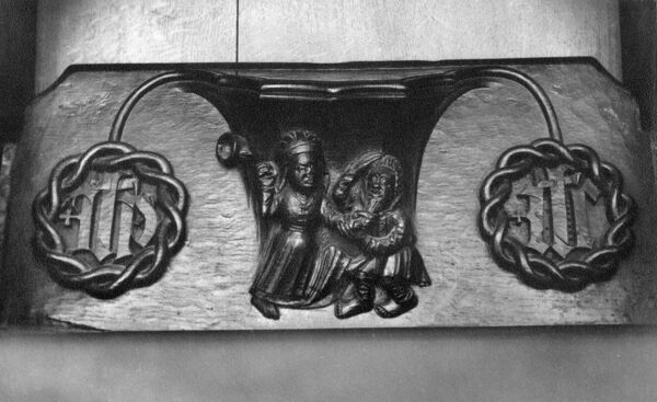 Holy Trinity Church, Old Town, Stratford-Upon-Avon, Warwickshire. Detail of a misericord showing a woman beating her husband. Photographed in the 1930s by William A Clark