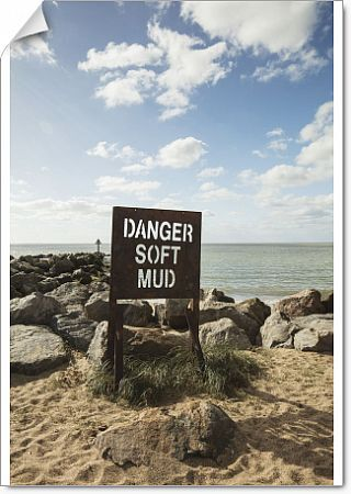 Jaywick Sands, Jaywick, Tendring, Essex. A sign on the beach reading 'Danger Soft Mud', with a rock breakwater beyond, October 2017