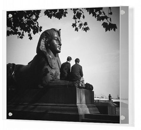 Victoria Embankment, Westminster, London. Two men sitting between the arms of the one of the bronze sphinxes at Cleopatra's Needle. Photographed before 1940