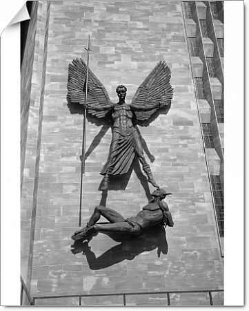 St Michaels Cathedral, Coventry, Coventry, Coventry. Detail of the Jacob Epstein sculpture of St Michael over Lucifer holding a long spear in his right hand, arms and wings outstretched, with Lucifer's feet bound by chains and his arms bound behind his back