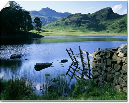 BLEA TARN, Lake District, Cumbria. View across the tarn showing the Langdale Pikes and Side Pikes beyond