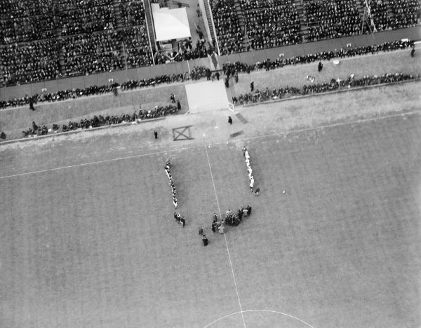 WEMBLEY STADIUM, Middlesex, London. The teams line up to greet the dignitaries before the 1928 FA Cup Final between Blackburn Rovers and Huddersfield Town. Blackburn won 3-1 in a match attended by 92,041. Photographed on 21st April 1928. Aerofilms Collection