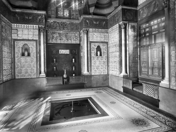 LEIGHTON HOUSE, 12 Holland Park Road, London. Home of the artist Lord Frederic Leighton (1830 - 1896) which is now a museum. Interior view of the Arab Room decorated with polychrome tiles. Photographed by Newton and Co. between 1896 and 1920