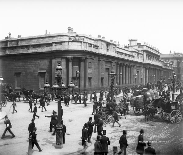 BANK OF ENGLAND, Threadneedle Street, City of London. A corner view of the Bank of England on Threadneedle Street with pedestrians and horse-drawn vehicles in the foreground. The building was constructed by Sir Hans Soane in 1788 in a 3.5 acre site