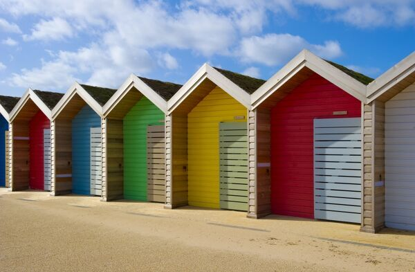 BEACH HUTS, Blyth, Northumberland. A row of different coloured beach huts