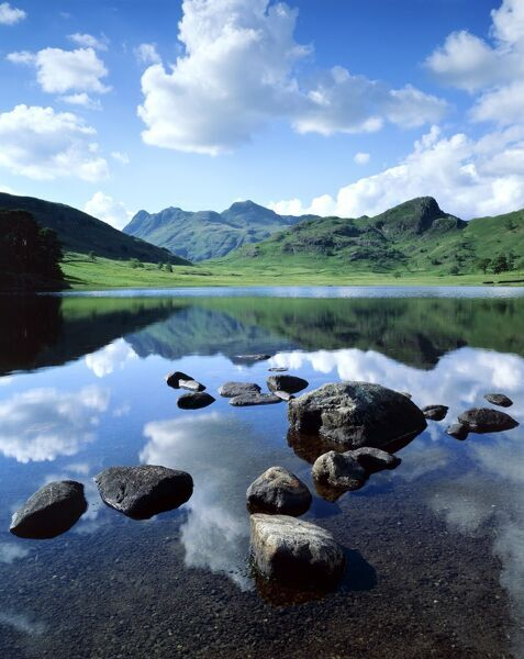 BLEA TARN, Lake District, Cumbria. A view across Blea Tarn showing reflections of the clouds on the waters surface