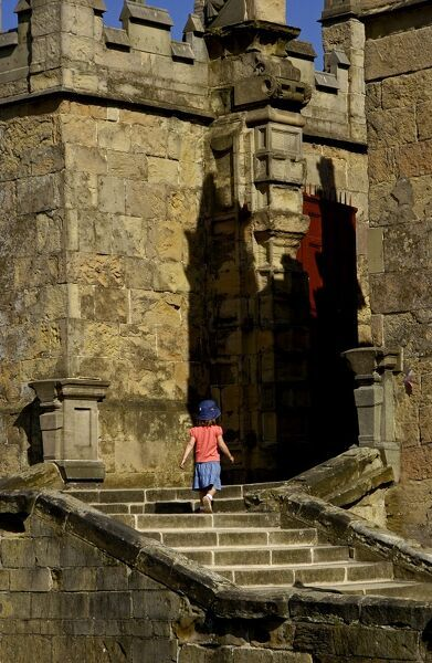 BOLSOVER CASTLE, Derbyshire. Little girl climbing the steps to the Little Castle
