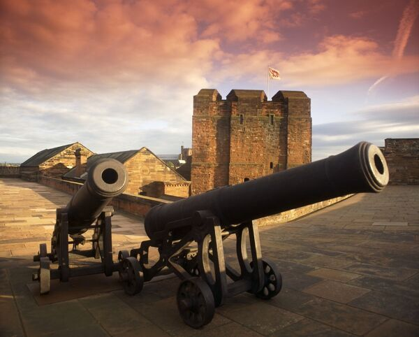 CARLISLE CASTLE, Cumbria. Two cannons on the wall walk with the 12th century keep in the background