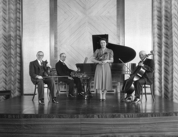 The Cecil Moon Quartet posed on a stage at The Royal Baths, Crescent Road, Harrogate, North Yorkshire. 1939. Walter Scott Collection