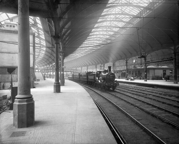 CENTRAL RAILWAY STATION, Newcastle Upon Tyne, Tyne and Wear. A steam train passing through the station in 1884. Bedford Lemere