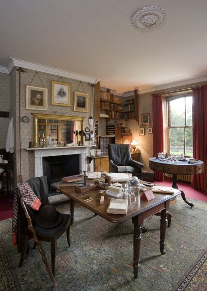 DOWN HOUSE, Kent. Interior view of the Old Study with walking stick and hat on chair
