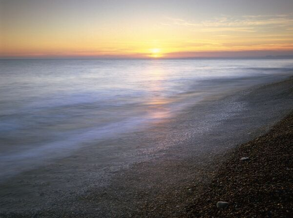 CHESIL BEACH, Dorset. View of the beach and sea at sunset